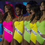 Contestants compete during the swimsuit segment of the Miss Venezuela 2012 pageant in Caracas