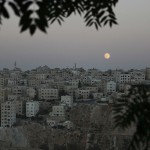 A full moon is seen in the sky of Jordanian capital Amman in Amman