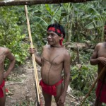 Yanomami Indians at the community of Irotatheri, are pictured during a government trip for journalists, as they wait to perform a dance to welcome an investigative commission