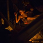 A Yanomami Indian woman sleeps on a hammock at her shack at the community of Irotatheri