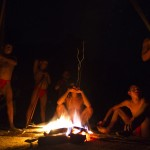 Yanomami Indians sit around a fire at the community of Irotatheri