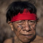 A Yanomami Indian chews leaves at the community of Irotatheri