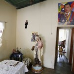Venezuelan President Chavez portraits and a puppet depicting him are seen at the living room of his aunt Brigida Frias' house in Sabaneta