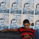 A man sits on a bench at Venezuela President Hugo Chavez's chilhood town of Sabaneta