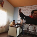 A man registers to be a member of the United Socialist Party at its office, which is located in the former house of Venezuela President Hugo Chavez's childhood town at Sabaneta