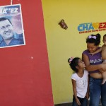 Children stand outside their house at Venezuela President Hugo Chavez's childhood village of Los Rastrojos in the state of Barinas