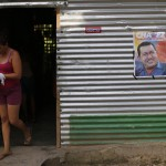 A woman walks past a door at her house in Venezuela President Hugo Chavez's childhood town of Sabaneta in the state of Barinas