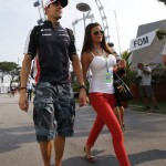Williams Formula One driver Maldonado of Venezuela and his girlfriend arrive before the third practice session of the Singapore F1 Grand Prix