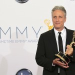 Jon Stewart hold the Emmy award for outstanding variety series for