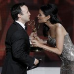 Strong accepts the award for outstanding writing for a miniseries or movie from presenter Liu at the 64th Primetime Emmy Awards in Los Angeles
