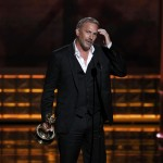 Kevin Costner accepts the award for outstanding lead actor in a miniseries or movie at the 64th Primetime Emmy Awards in Los Angeles