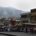 Venezuelans line up before casting their vote during Presidential election in Caracas