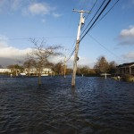 Homes are surrounded by floodwaters pushed up by high tide and the storm surge from Hurricane Sandy in Westhampton Beach
