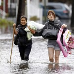 Residents make their way through flood waters brought on by Hurricane Sandy in Little Ferry