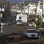 Residents survey damage to homes along the shoreline after Hurricane in Sandy Milford