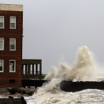 Waves crash against demolished section of a boardwalk in the aftermath of Hurricane Sandy's landfall in Atlantic City