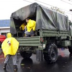 Residents are rescued by by a national guard truck from flood waters brought on by Hurricane Sandy in Little Ferry