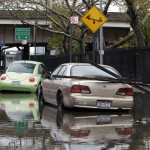 Parked cars are partially submerged in flood waters in the aftermath of Hurricane Sandy in New York