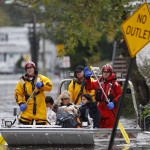 Residents are rescued by emergency personnel from flood waters brought on by Hurricane Sandy in Little Ferry
