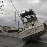 Boats rest on Broadway Avenue after they were washed ashore from a boatyard during Hurricane Sandy in Point Pleasant Beach