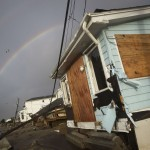 A rainbow is seen among homes devastated by the effects of Hurricane Sandy at the Breezy Point section of the Queens borough of New York