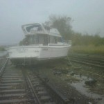 A boat rests on the tracks at Metro-North's Ossining Station on the Hudson Line in the aftermath of Hurricane Sandy, in New York