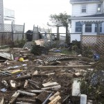 Debris litters the property of a home from the effects of Hurricane Sandy in Milford, Connecticut