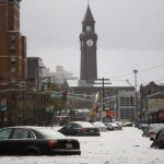 Car are seen on a street flooded at Hoboken in New Jersey