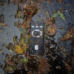 A remote control lies partially submerged in water on 14th street of Manhattan after the storms from last night's Hurricane Sandy in New York
