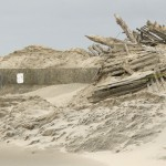 Piles of sand and debris from hurricane Sandy cover the parking meters on the seawall along Beach Avenue in Cape May