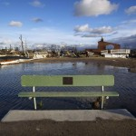 A bench sits in front of the wreckage of homes devastated by fire and the effects of Hurricane Sandy in the Breezy Point section of the Queens borough of New York