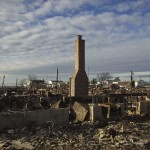 The wreckage of homes devastated by fire and the effects of Hurricane Sandy are seen in the Breezy Point section of the Queens borough of New York