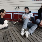 Atlantic City residents Khan, Milton, and Elizabeth Wencel, all who are without power in their homes, recharge their cellphones and those of friends from an outdoor electrical outlet at one one of the boardwalk casinos in Atlantic City