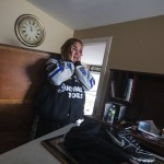 Renter Donna McBride reacts to seeing the damage done to her home by the storm surge of Hurricane Sandy in Lindenhurst, New York