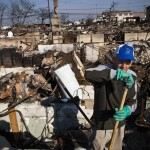 McLoughlin surveys the damage to his home, which burned to the ground during Hurricane Sandy, in the Breezy Point neighborhood of Queens, New York