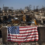 A U.S. flag is seen hanging in the Breezy Point neighborhood of Queens, New York