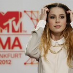 German singer Lena poses on the red carpet for the MTV European Music Awards 2012 at the Festhalle in Frankfurt