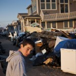 A boy surveys the damage caused by Hurricane Sandy in the Breezy Point neighborhood of Queens, New York