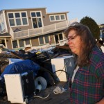 A resident surveys the damage to her home after Hurricane Sandy swept through the Breezy Point neighborhood of Queens
