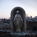 A Virgin Mary statue is seen amongst the rubble of a destroyed row of houses after Hurricane Sandy hit, in the Breezy Point neighborhood of Queens