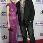 Singer Carrie Underwood and her husband, NHL hockey player Mike Fisher, arrive at the 40th American Music Awards in Los Angeles