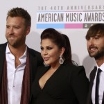 Country group Lady Antebellum arrive at the 40th American Music Awards in Los Angeles