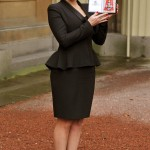 Actress Kate Winslet holds her CBE which was awarded to her by Britain's Queen Elizabeth at Buckingham Palace in central London