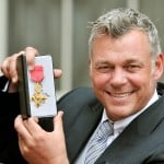 Golfer Darren Clarke holds his OBE awarded to him by Britain's Queen Elizabeth at Buckingham Palace in central London