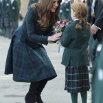 Britain's Catherine, Duchess of Cambridge, speaks to a student during a visit to her former preparatory school St. Andrew's in Berkshire, southern England