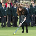 Britain's Catherine, Duchess of Cambridge, plays hockey during a visit to her former preparatory school St. Andrew's, which she attended from 1986 to 1995, in Berkshire, southern England
