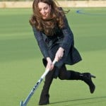 Britain's Catherine, Duchess of Cambridge, plays hockey during a visit to her former preparatory school St. Andrew's near Pangbourne, southern England
