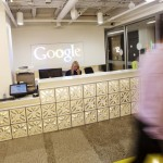 A man walks by the reception desk at the new Google office in Toronto