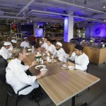 The food preparation team sit down to eat at the new Google office in Toronto
