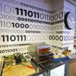 Binary code is written on the wall of the kitchen that displays Google company messages at the new Google office in Toronto
